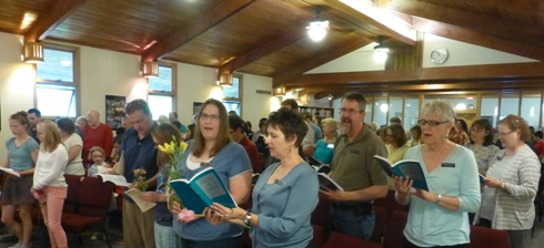 Congregation singing a hymn